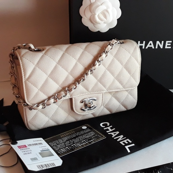95cad35ec137 CHANEL Handbags - CHANEL LIGHT BEIGE CAVIAR MINI CLASSIC FLAP BAG